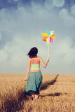 Girl with wind turbine. At wheat field Stock Image
