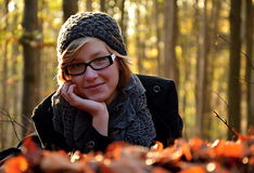 Girl in windfall leaves Royalty Free Stock Photo