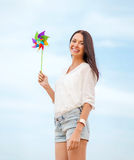 Girl with windmill toy on the beach Stock Images