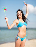 Girl with windmill toy on the beach Stock Photo
