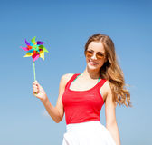 Girl with windmill toy on the beach Stock Photos