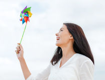Girl with windmill toy on the beach Stock Photography