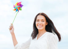 Girl with windmill toy on the beach Stock Image