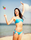 Girl with windmill toy on the beach Royalty Free Stock Photography
