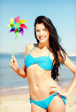 Girl with windmill toy on the beach Royalty Free Stock Images