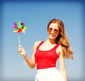 Girl with windmill toy on the beach Royalty Free Stock Image