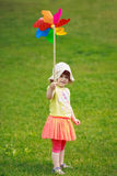 Girl with windmill toy stock photos