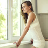 Girl at the window Royalty Free Stock Photo
