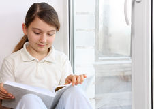 Girl at the window Royalty Free Stock Images