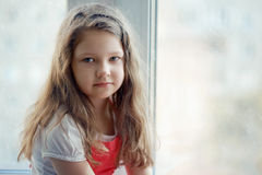 Girl at the Window Royalty Free Stock Photos