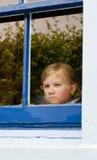 Girl at the window stock photos