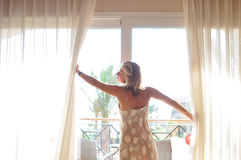 Girl at the window. In the morning Stock Photo