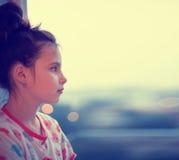 Girl on window Stock Image