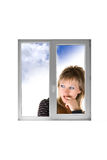 Girl at window Royalty Free Stock Images