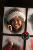 Girl in Window with Candy Cane Royalty Free Stock Image