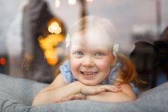 Girl in window Stock Photos