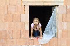 Girl in the window Royalty Free Stock Images