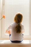 Girl on window-sill Royalty Free Stock Photos