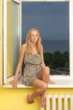 Girl on the windowsill Stock Photo