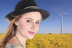 Girl with windturbine Stock Photography