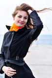 Girl in windy weather Stock Images