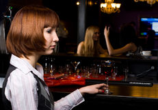 Girl with wine. Young woman drinking red wine in bar Royalty Free Stock Photo