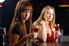 Girl with wine. Young woman drinking red wine in bar Royalty Free Stock Images