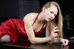 Girl with wine. Young woman drinking red wine in bar Stock Images