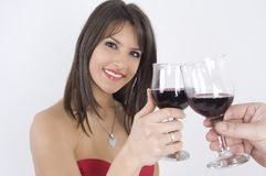 Girl and wine. Pretty girl in red dress drinking wine Stock Photo
