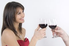 Girl and wine. Pretty girl in red dress drinking wine Royalty Free Stock Photo