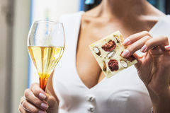 Girl with wine and chocolate. Closeup photo Royalty Free Stock Photo