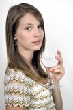 Girl with wine glass. Studio image of girl holding wine glass.  She was 19 at the time of shoot and is of Irish ethnicity Royalty Free Stock Photography