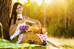 Girl with wine on nature Royalty Free Stock Images