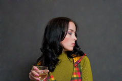 Girl with wine in squared waistcoat Royalty Free Stock Image