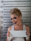 Girl wink in prison. White girl wink  in prison with injuries on ruler background Royalty Free Stock Images