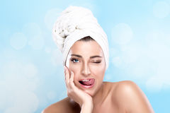 Girl Winking with Funny Expression. Spa Woman Stock Photo