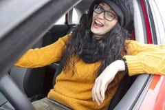 Girl winking her eye. In her car Stock Image