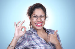 Girl Winking with thumb up and ok sign Stock Photos