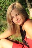 Girl winks Stock Image