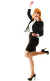 Girl winner celebrating success in job. Success in business work. Young businesswoman in full length happy girl winner shouting for joy, celebrating promotion in Stock Images