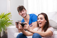 Girl wins the match on the videogames Royalty Free Stock Photos
