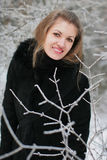 A girl in winter. Beautiful girl in winter forest, Lithuania Stock Photos