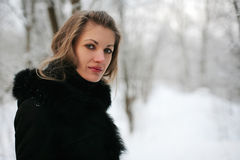 A girl in winter. Beautiful girl in winter forest, Lithuania Stock Photography