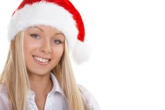 The girl winter. The beautiful girl in a christmas red cap Royalty Free Stock Image