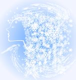 Girl winter. A light blue background profile girl created from the blizzards and snow flakes Stock Photos
