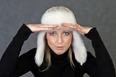 Girl with winter cap Stock Photos