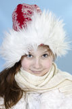 Girl in winter cap Stock Photography