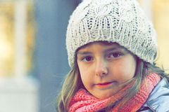 Girl in winter cap Royalty Free Stock Photography