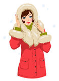 Girl in winter clothes. Beautiful girl in a red winter jacket Stock Images