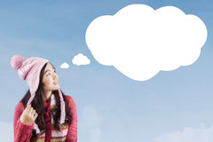Girl with winter clothes and cloud bubble Royalty Free Stock Photo